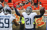 Tennessee Titans cornerback Malcolm Butler (21) celebrates with teammates after Butler intercepted for a 38-yard touchdown during the second half in an NFL football game, Sunday, Sept. 8, 2019, in Cleveland. The Titans won 43-13. (AP Photo/Ron Schwane)