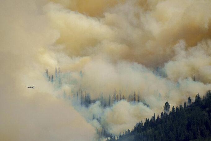 The Parleys Canyon Fire burns, Saturday, Aug. 14, 2021, in Utah. (Trent Nelson/The Salt Lake Tribune via AP)