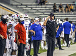 Louisiana Tech head coach Skip Holts, right, watches an NCAA college football game against Southern Mississippi in Hattiesburg, Miss., Saturday, Sept. 19, 2020. (Cam Bonelli/Hattiesburg American via AP)