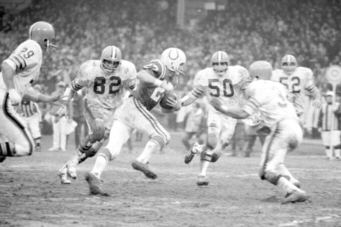 FILE - In this Dec. 26, 1971, file photo, Baltimore wide receiver Ray Perkins is surrounded by Cleveland Browns defenders including Jim Houston (82) and John Garlington (50) after picking up 13-yards in the second half of the AFC Championship game in Cleveland. Perkins, who replaced Hall of Famer Bear Bryant as Alabama's football coach and started the transition with the New York Giants that led to two Super Bowl titles, died Wednesday morning, Dec. 9, 2020, in Tuscaloosa. He was 79. The school announced his passing on Wednesday, and daughter Rachael Perkins posted news of his death on her Facebook page. (AP Photo/File)