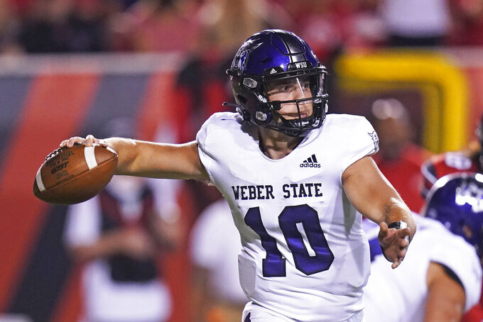 Weber State quarterback Bronson Barron looks for a receiver during the second half of the team's NCAA college football game against Utah on Thursday, Sept. 2, 2021, in Salt Lake City. (AP Photo/Rick Bowmer)