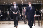 U.S. Special Representative for North Korea Stephen Biegun, left, and Japanese Vice Foreign Minister Takeo Akiba, right, walk together prior to their bilateral meeting at Iikura Guest House Thursday, July 9, 2020, in Tokyo. (AP Photo/Eugene Hoshiko, Pool)