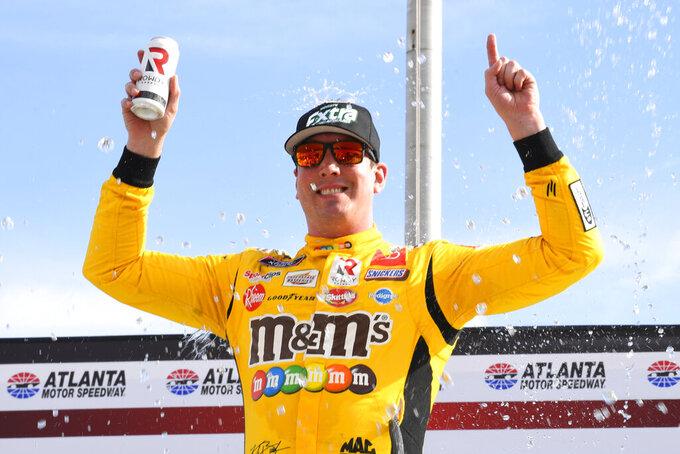 Kyle Busch celebrates in Victory Lane after wining a NASCAR Xfinity Series auto race Saturday, July 10, 2021, in Hampton, Ga. (AP Photo/John Amis)
