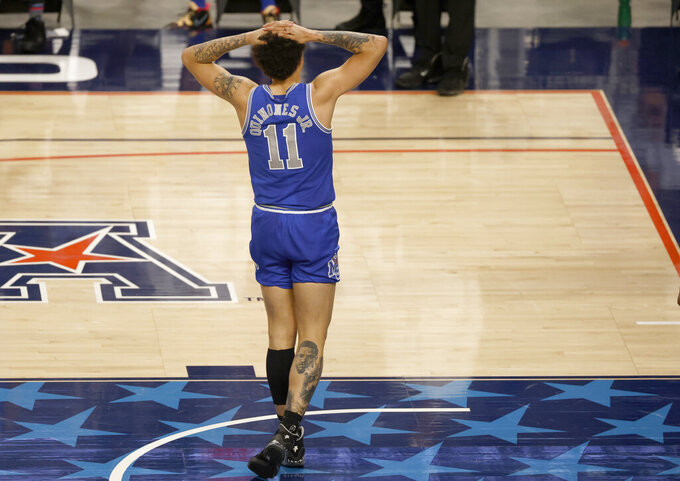 Memphis guard Lester Quinones (11) reacts as Memphis plays Houston late in the second half of an NCAA college basketball game in the semifinal round of the American Athletic Conference men's tournament Saturday, March 13, 2021, in Fort Worth, Texas.  (AP Photo/Ron Jenkins)