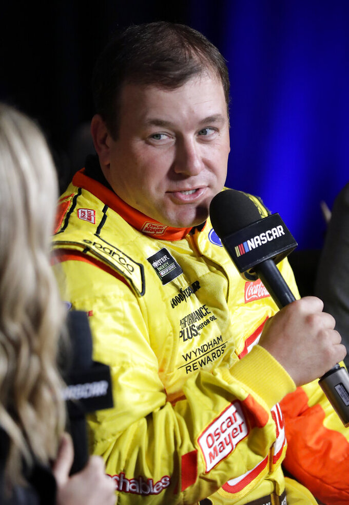 Ryan Newman answers questions during an interview at NASCAR Daytona 500 auto racing media day at Daytona International Speedway, Wednesday, Feb. 13, 2019, in Daytona Beach, Fla. (AP Photo/John Raoux)