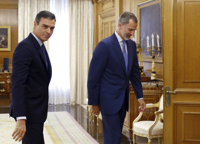 Spain's caretaker Prime Minister Pedro Sanchez, left, follows Spain's King Felipe VI into a meeting at the Zarzuela Palace on the outskirts of Madrid, Spain, Tuesday Sept. 17, 2019. Spain's King Felipe VI is wrapping up two days of talks with political party leaders, hoping he can find a candidate that can win parliament's backing to form a government and avert a second national election this year. (Ballesteros, Pool photo via AP)