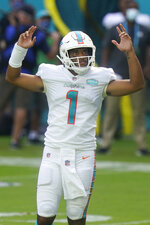 Miami Dolphins quarterback Tua Tagovailoa (1) gestures during the first half of an NFL football game against the Los Angeles Rams, Sunday, Nov. 1, 2020, in Miami Gardens, Fla. (AP Photo/Lynne Sladky)