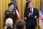 President Donald Trump awards the Medal of Honor to Army Sgt. Maj. Thomas P. Payne in the East Room of the White House, Friday, Sept. 11, 2020, in Washington. (AP Photo/Andrew Harnik)