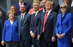 From left to right, German Chancellor Angela Merkel, Belgium's Prime Minister Charles Michel, NATO Secretary General Jens Stoltenberg, President Donald Trump,and Britain's Prime Minister Theresa May, look up in sky during a ceremonial fly-over ahead of the opening ceremony of the NATO (North Atlantic Treaty Organization) summit, at the NATO headquarters in Brussels, Wednesday, July 11, 2018.(AP Photo/Pablo Martinez Monsivais)
