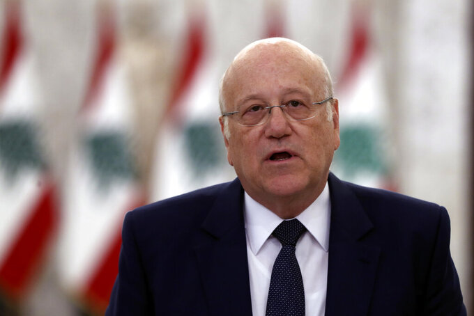 Lebanese Prime Minister-designate Najib Mikati, speaks to journalists after his meeting with Lebanese President Michel Aoun, at the Presidential Palace in Baabda, east of Beirut, Lebanon, Monday, July 26, 2021. Lebanon's president appointed Mikati, a billionaire businessman and former prime minister as the next premier-designate Monday, after Saad Hariri earlier this month gave up attempts to form a Cabinet amid an unprecedented financial meltdown roiling the country. (AP Photo/Bilal Hussein)