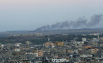 Smoke rises from a mortar attack by Gaza militants on Israel, in Gaza City, Monday, Nov. 12, 2018. Palestinian militants on Monday fired dozens of rockets and mortar shells into southern Israel, critically wounding an Israeli teen, in an intense barrage of projectiles aimed at seeking revenge for a deadly Israeli military incursion late Sunday. The Israeli military responded by dispatching fighter jets to strike throughout the Gaza Strip. (AP Photo/Adel Hana)