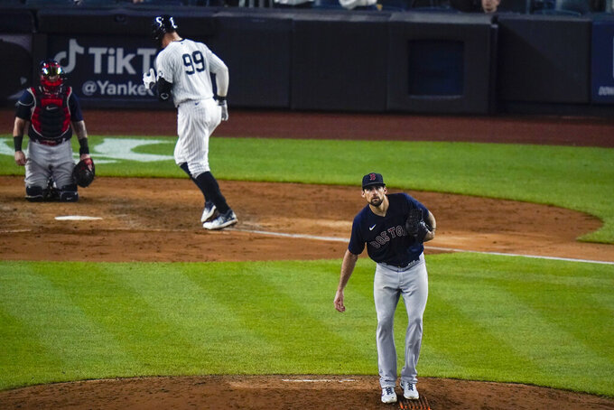 Boston Red Sox starting pitcher Nathan Eovaldi, right, reacts as New York Yankees' Aaron Judge (99) runs the bases after hitting a home run during the sixth inning of a baseball game Friday, June 4, 2021, in New York. (AP Photo/Frank Franklin II)