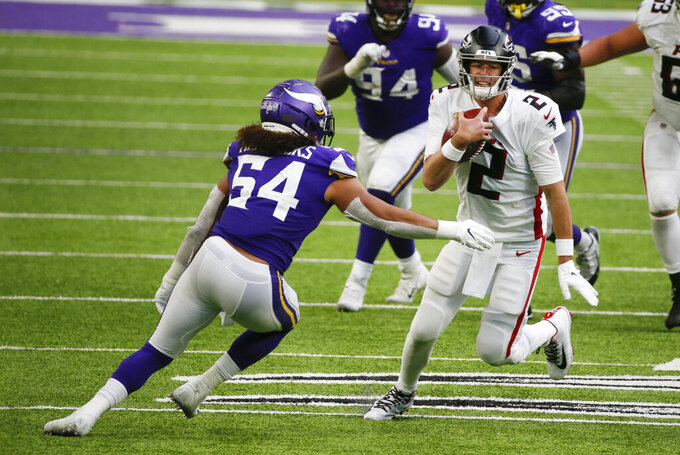 Atlanta Falcons quarterback Matt Ryan (2) runs from Minnesota Vikings linebacker Eric Kendricks during the second half of an NFL football game, Sunday, Oct. 18, 2020, in Minneapolis. (AP Photo/Bruce Kluckhohn)