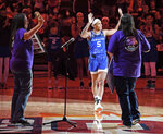 Connecticut Sun guard Jasmine Thomas (5) comes forward to accept the inaugural Gladys Tantaquidgeon Award from members of the Mohegan Tribe Council of Elders on the court after a win over the Atlanta Dream in a WNBA basketball game Sunday, Sept. 19, 2021, in Uncasville, Conn. (Sean D. Elliot/The Day via AP)
