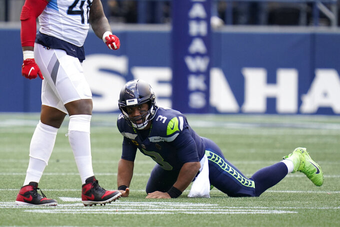 Seattle Seahawks quarterback Russell Wilson looks up after an incomplete pass against the Tennessee Titans late in the fourth quarter of an NFL football game, Sunday, Sept. 19, 2021, in Seattle. The Titans won 33-30 in overtime. (AP Photo/Elaine Thompson)