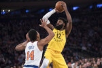 Indiana Pacers guard Tyreke Evans (12) shoots over New York Knicks guard Allonzo Trier (14) during the first half of an NBA basketball game Friday, Jan. 11, 2019, at Madison Square Garden in New York. (AP Photo/Mary Altaffer)