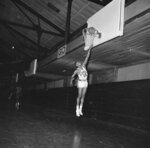 FILE - In this Feb. 20, 1963, file photo, Loyola University's star basketball player Jerry Harkness shows his form on a court in Chicago. Harkness, who led Loyola Chicago to a barrier-breaking national basketball championship and a was civil rights pioneer, has died. He was 81. The school announced Harkness passed away Tuesday morning, Aug. 24, 2021. (AP Photo/Paul Cannon, File)
