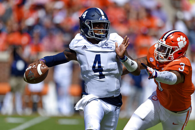 Georgia Southern quarterback Shai Werts (4) is pressured by Clemson's Xavier Thomas during the first half of an NCAA college football game Saturday, Sept. 15, 2018, in Clemson, S.C. (AP Photo/Richard Shiro)