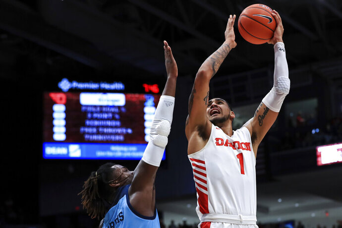 Rhode Island's Jermaine Harris, left, defends as Dayton's Obi Toppin drives to the basket during the first half of an NCAA college basketball game, Tuesday, Feb. 11, 2020, in Dayton, Ohio. (AP Photo/Aaron Doster)