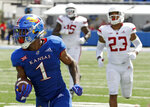 FILE - In this Saturday, Sept. 15, 2018 file photo, Kansas running back Pooka Williams Jr. (1) runs the ball for a touchdown during the second half of an NCAA college football game against Rutgers in Lawrence, Kan. This season, four Big 12 backs are averaging at least 100 yards rushing per game in conference action. A fifth, Kansas' Pooka Williams, is averaging 100 yards rushing for the season and ranks in the top 25 nationally in yards rushing per game. (AP Photo/Charlie Riedel, File)