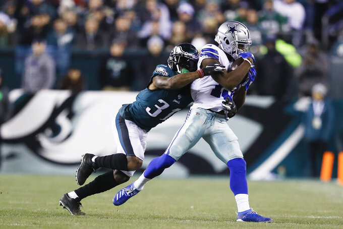 Dallas Cowboys wide receiver Michael Gallup, right, catches a pass as Philadelphia Eagles cornerback Jalen Mills defends during the first half of an NFL football game Sunday, Dec. 22, 2019, in Philadelphia. (AP Photo/Michael Perez)