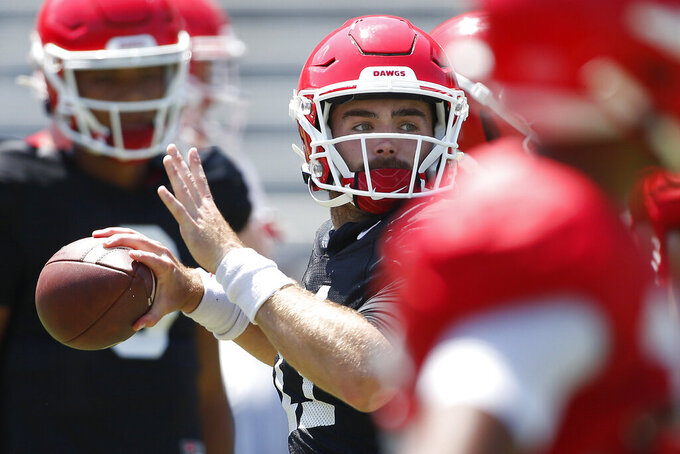 Georgia quarterback Jake Fromm (11) looks to throw a pass during warm ups for an NCAA football preseason scrimmage in Athens, Ga., on Saturday, Aug. 17, 2019. (Joshua L. Jones/Athens Banner-Herald via AP)
