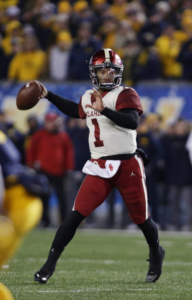 Oklahoma quarterback Kyler Murray (1) looks for a receiver during the second half of an NCAA college football game against West Virginia on Friday, Nov. 23, 2018, in Morgantown, W.Va. (AP Photo/Raymond Thompson)
