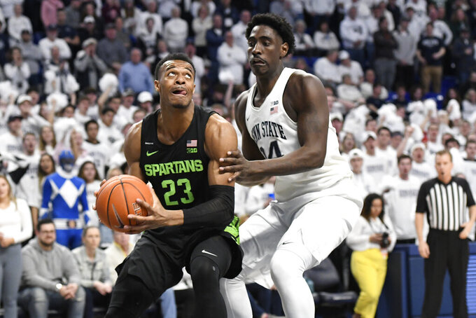 Michigan State's Xavier Tillman Sr. (23) tries to get past Penn State's Mike Watkins (24) during the first half of an NCAA college basketball game Tuesday, March 3, 2020, in State College, Pa. (AP Photo/John Beale)