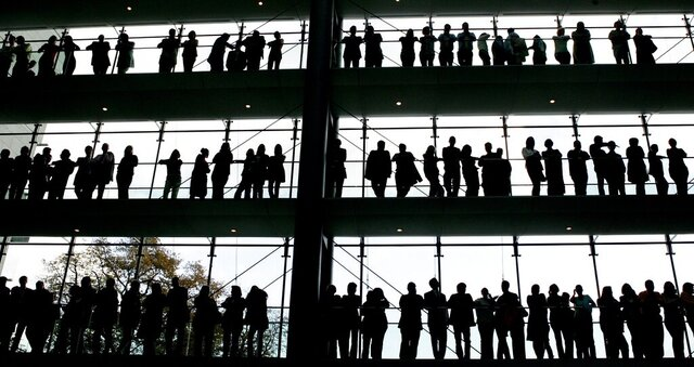 FILE - In this Oct. 30, 2007 file photo, employees are silhouetted at the Boehringer Ingelheim pharmaceutical factory in Ingelheim, central Germany. New statistics show unemployment in Germany fell unexpectedly in October, suggesting that Europe's largest economy was beginning to shake off the negative impact of the coronavirus just as the pandemic started to spread rapidly again. (AP Photo/Michael Pobst, file)