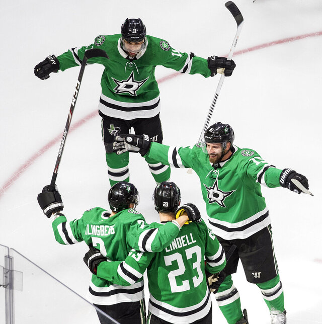 Dallas Stars players celebrate a goal by John Klingberg against the Colorado Avalanche during the first period of an NHL hockey second-round playoff series, Sunday, Aug. 30, 2020, in Edmonton, Alberta. (Jason Franson/The Canadian Press via AP)