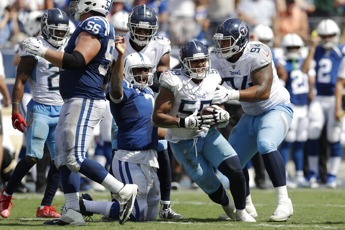 Tennessee Titans linebacker Harold Landry (58) celebrates after recovering a fumble by Indianapolis Colts quarterback Jacoby Brissett (7) in the second half of an NFL football game Sunday, Sept. 15, 2019, in Nashville, Tenn. (AP Photo/James Kenney)