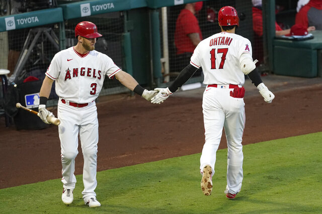 Los Angeles Angels designated hitter Shohei Ohtani, right, celebrates hitting a solo home run with Taylor Ward during the second inning of a baseball game against the Texas Rangers, Saturday, Sept. 19, 2020, in Anaheim, Calif. (AP Photo/Ashley Landis)