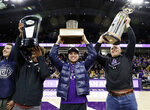 CORRECTS ID TO TOMMY DOLES NOT TREY KLOCK Northwestern football players Paddy Fisher, left, hold the Big 10 West Division Champion trophy, Isaiah Bowser, center, the Land of Lincoln Trophy and Tommy Doles holds the Holiday Bowl Champion trophy during the first half of an NCAA college basketball game against Iowa, Wednesday, Jan. 9, 2019, in Evanston, Ill. (AP Photo/Nam Y. Huh)