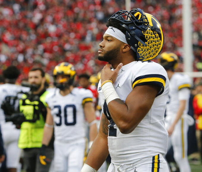 Michigan receiver Nico Collins walks off the field after Ohio State beat Michigan in an NCAA college football game Saturday, Nov. 24, 2018, in Columbus, Ohio. Ohio State beat Michigan 62-39. (AP Photo/Jay LaPrete)