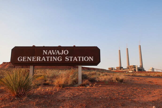 This Aug. 19, 2019, image shows the coal-fired Navajo Generating Station near Page, Ariz. The power plant will close before the year ends, upending the lives of hundreds of mostly Native American workers who mined coal, loaded it and played a part in producing electricity that powered the American Southwest. (AP Photo/Felicia Fonseca)
