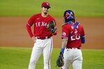 Texas Rangers starting pitcher Kohei Arihara talks with catcher Jonah Heim on the mound during the first inning of the team's baseball game against the Boston Red Sox in Arlington, Texas, Friday, April 30, 2021. (AP Photo/Tony Gutierrez)