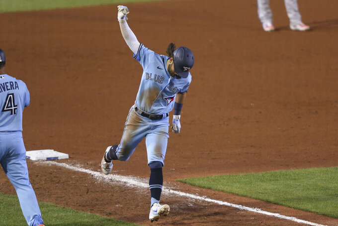 Toronto Blue Jays' Bo Bichette celebrates his home run off Miami Marlins pitcher Brad Boxberger during the eighth inning of a baseball game, Wednesday, Aug. 12, 2020, in Buffalo, N.Y. (AP Photo/Jeffrey T. Barnes)