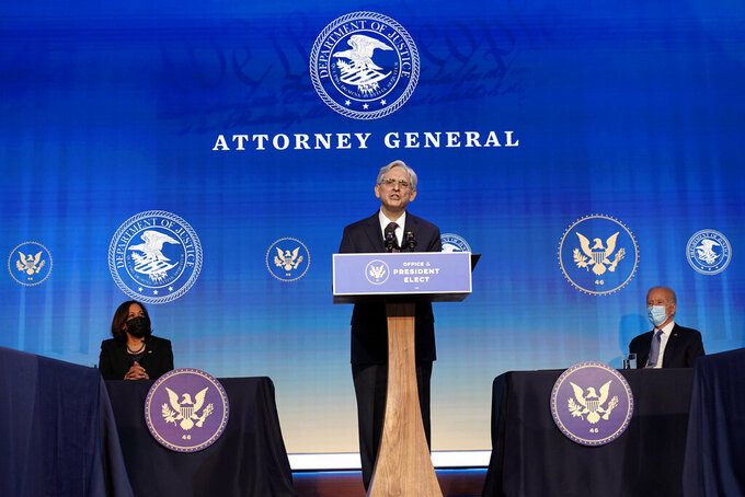 FILE - In this Jan. 7, 2021, file photo Attorney General nominee Judge Merrick Garland speaks during an event with President-elect Joe Biden and Vice President-elect Kamala Harris at The Queen theater in Wilmington, Del. The once-snubbed Supreme Court pick will finally come before the Senate, this time as President Joe Biden's choice for attorney general. Garland, an appeals court judge, is widely expected to sail through his confirmation process, beginning Monday at a hearing, with bipartisan support. (AP Photo/Susan Walsh, File)