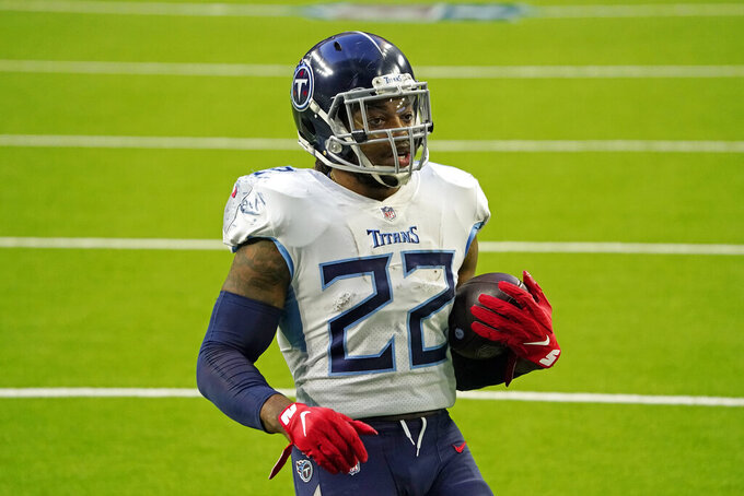 Tennessee Titans running back Derrick Henry (22) rushes for a touchdown against the Houston Texans during the second half of an NFL football game Sunday, Jan. 3, 2021, in Houston. (AP Photo/Sam Craft)