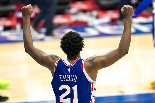 Philadelphia 76ers' Joel Embiid reacts to the 137-134 overtime win in an NBA basketball game against the Miami Heat, Tuesday, Jan. 12, 2021, in Philadelphia. (AP Photo/Chris Szagola)