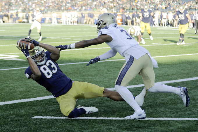 Notre Dame wide receiver Chase Claypool (83) makes a touchdown reception against Navy cornerback Cameron Kinley (3) during the first half of an NCAA college football game, Saturday, Nov. 16, 2019, in South Bend, Ind.(AP Photo/Darron Cummings)