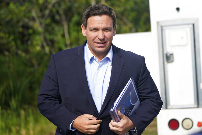 FILE - In this Tuesday, Aug. 3, 2021, file photo, Florida Gov. Ron DeSantis arrives at a news conference, near the Shark Valley Visitor Center in Miami. On Sunday, Sept. 12, three Republican presidential prospects, including DeSantis, sharply condemned President Joe Biden's handling of the end of the war in Afghanistan, rebuking the administration's conduct of the U.S. withdrawal as weak and as emboldening its adversaries. (AP Photo/Wilfredo Lee, File)