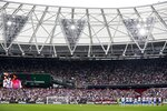 Players and fans commemorate Jimmy Greaves, one of England's greatest goal-scorers, ahead of the English Premier League soccer match between West Ham United and Manchester United at the London Stadium in London, England, Sunday, Sept. 19, 2021. Greaves who was prolific for Tottenham, Chelsea and AC Milan has died. He was 81. With 266 goals in 379 appearances, Greaves was the all-time record scorer for Tottenham, which announced his death on Sunday, Sept. 19, 2021. (AP Photo/Ian Walton)