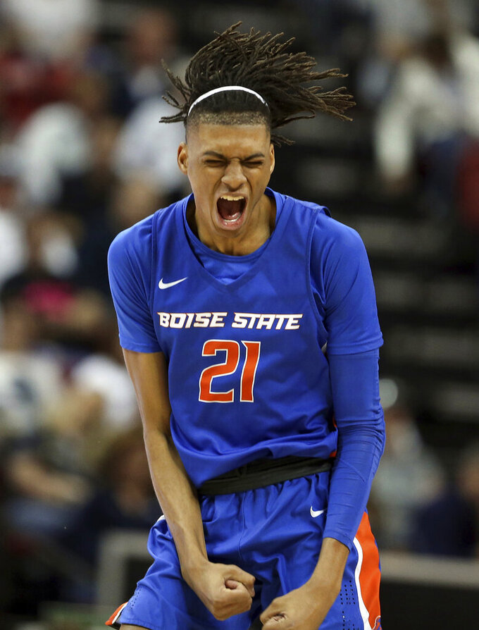 Boise State's Derrick Alston celebrates after sinking a 3-point shot during the first half of an NCAA college basketball game against Nevada in the Mountain West Conference men's tournament Thursday, March 14, 2019, in Las Vegas. (AP Photo/Isaac Brekken)