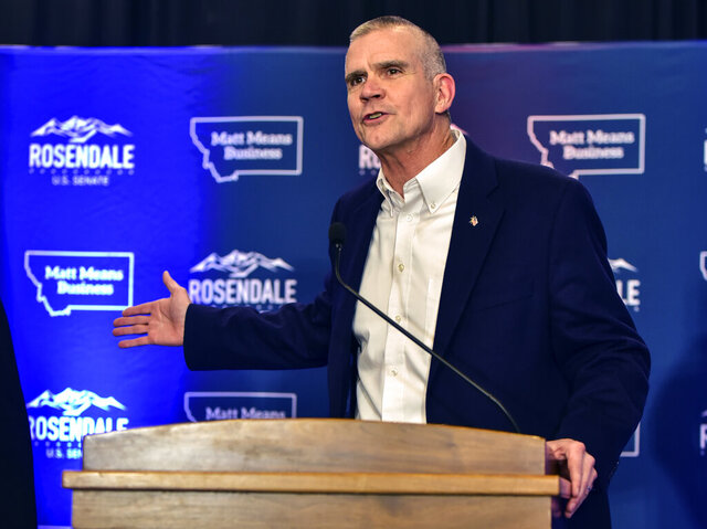 FILE – In this Nov. 6, 2018, file photo, Matt Rosendale greets supporters in Helena, Montana. In the race for Montana's lone U.S. House seat, Republican Matt Rosendale faces opponent Democrat Kathleen Williams. (AP Photo/Eliza Wiley, File)