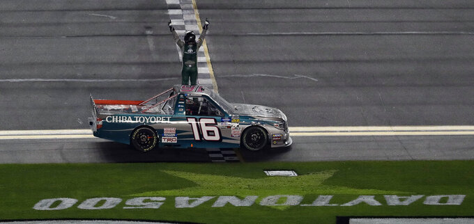 Austin Hill (16) celebrates his win in a NASCAR Truck Series auto race Friday, Feb. 15, 2019, at Daytona International Speedway in Daytona Beach, Fla. (AP Photo/Chris O'Meara)
