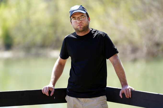 """Daniel Roberts poses for a picture Monday, April 5, 2021, in McMinnville, Tenn. Roberts received a COVID vaccine over the objections of his family, who are against being vaccinated. """"Five hundred thousand people have died in this country. That's not a hoax,"""" Roberts said, speaking of the conspiracy theories he hears from family and friends. """"I don't know why I didn't believe all of it myself. I guess I chose to believe the facts."""" (AP Photo/Mark Humphrey)"""