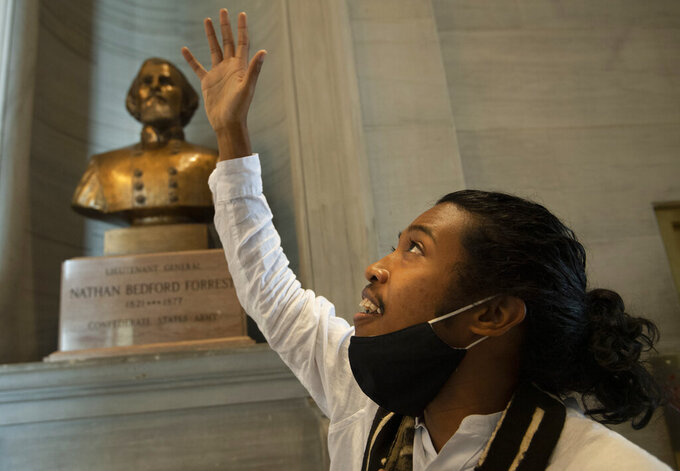Activist Justin Jones gives praise to God in front of the Nathan Bedford Forrest bust in the State Capitol Thursday, July 22, 2021 in Nashville, Tenn., after the removal of the bust was approved by by the State Building Commission. Jones led protests over the summer of 2020 to have the bust removed. A decadeslong effort to remove the bust from the Tennessee Capitol cleared its final hurdle Thursday, with state leaders approving the final vote needed to allow the statue to be relocated to a museum. (George Walker IV/The Tennessean via AP)