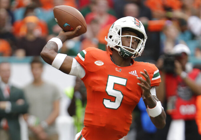 Miami quarterback N'Kosi Perry (5) passes during the first half of an NCAA college football game against Pittsburgh, Saturday, Nov. 24, 2018, in Miami Gardens, Fla. (AP Photo/Lynne Sladky)
