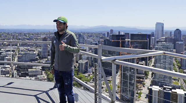Seattle Sounders captain and MLS soccer midfielder Nicolas Lodeiro poses for a photo after he took part in a flag raising for the launch of the